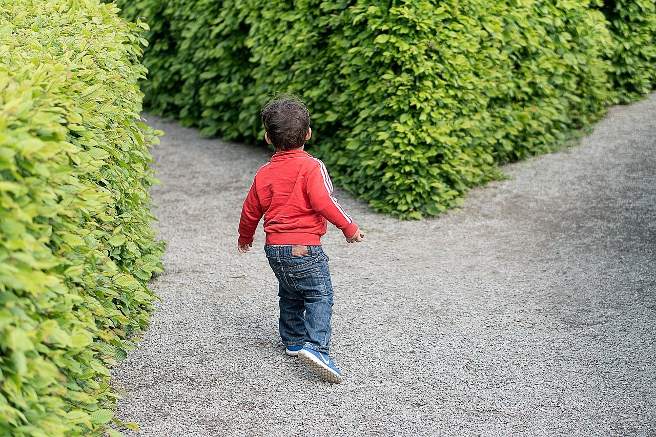 Child at cross-road within a maze