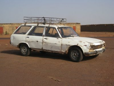 Battered 7 seater Peugeot estate - a typical bush taxi