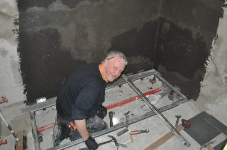 Martin fitting the base for the shower tray