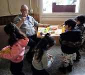 Neal with children in Oasis centre, 'playing tea parties'