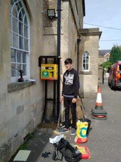 Nattie during installation of defibrillator box